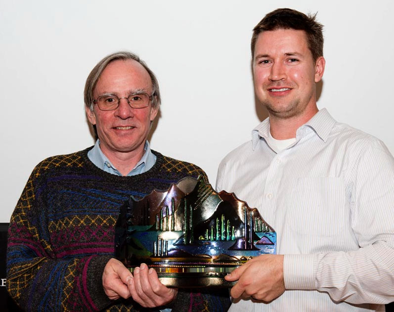 Gordon receiving his prize for Best Book of Mountain and Wilderness Literature 2012 from Brett Oland of the John Whyte Museum, Banff