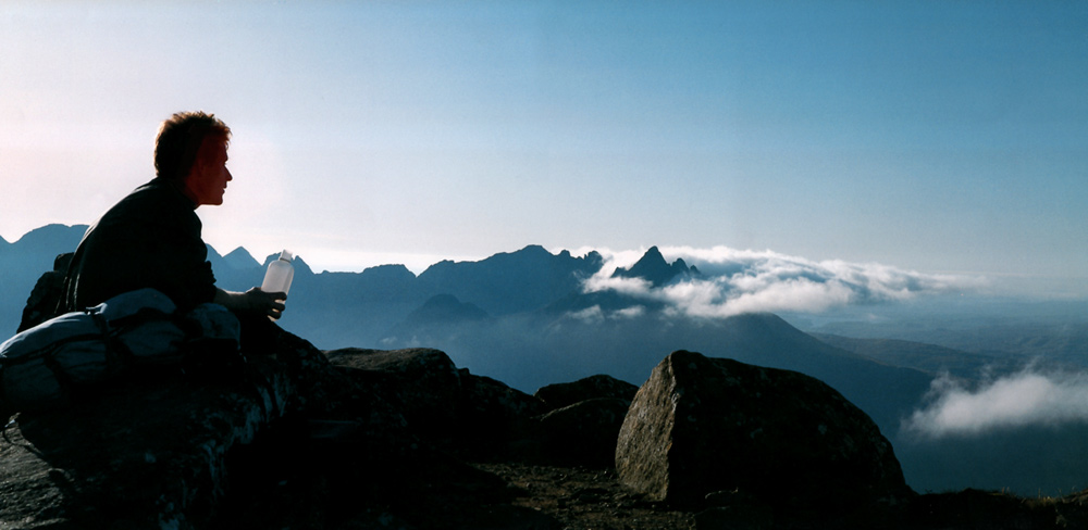 Mike Lates on the summit of Blaven after completing the Greater Cuillin Traverse in a heatwave in 11 1/4 hours, September 1993. Photo: Gordon Stainforth, Fuji 690 camera
