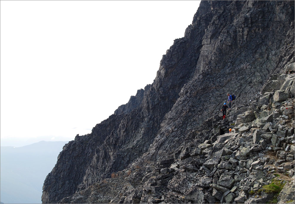 Reaching easy ground on the descent of Store Trolltind. Gordon suffering from vertigo being shepherded back to safety by Bjorn. Photo: John Stainforth