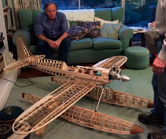 Author Gordon Stainforth looking at his brother's partly completed model of the Supermarine S6B
